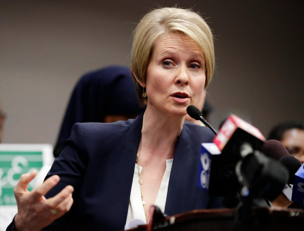 FILE - In this March 26, 2018 file photo, New York Democratic gubernatorial candidate Cynthia Nixon responds to a question during a news conference in Albany, N.Y. Nixon, who has never held an elected office, is challenging Cuomo, a two-term incumbent, for the Democratic Party nomination in September. (AP Photo/Frank Franklin II, File)